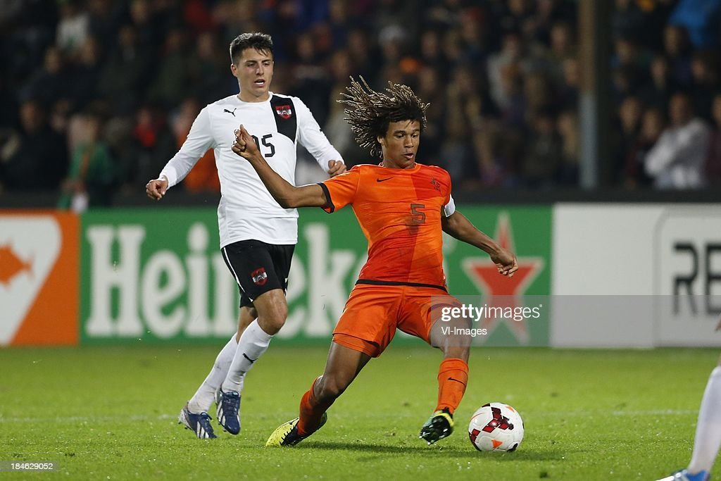 Alessandro Schopf of Austria U21, Nathan Ake of Netherlands U21 during 2015 UEFA European U21 Championships Qualifier match between the Netherlands U21 and Austria U21 at the Adelaarshorst on Oktober 14, 2013 in Deventer, The Netherlands