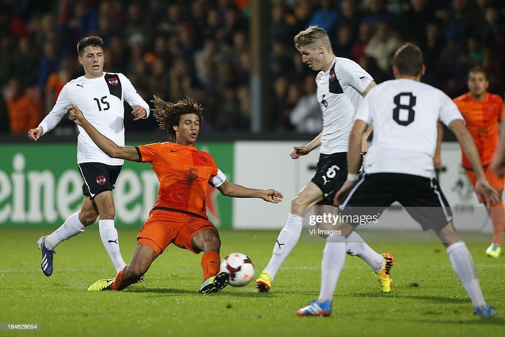 Alessandro Schopf of Austria U21, Nathan Ake of Netherlands U21, Simon Piesinger of Austria U21 during 2015 UEFA European U21 Championships Qualifier match between the Netherlands U21 and Austria U21 at the Adelaarshorst on Oktober 14, 2013 in Deventer, The Netherlands