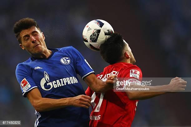 Alessandro Schopf of Schalke battles for the ball with Jairo Samperio of FSV Mainz 05 during the Bundesliga match between FC Schalke 04 and 1 FSV...
