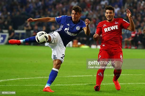 Alessandro Schopf of Schalke shoots on goal in front of Milos Jojic of koeln during the Bundesliga match between FC Schalke 04 and 1 FC Koeln at...