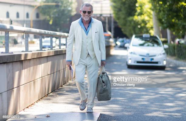 Alessandro Squarzi wearing a creme suit weekender bag is seen during Pitti Immagine Uomo 92 at Fortezza Da Basso on June 13 2017 in Florence Italy