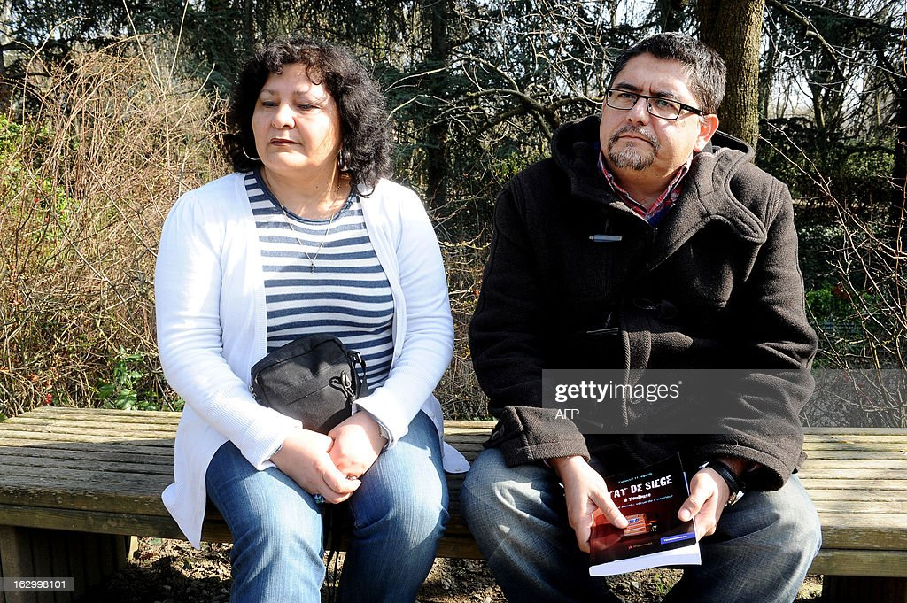 Alessandro Vargas (R) and his wife Viviana, the next-door neighbours of late Islamist gunman Mohamed Merah, explain why they wrote the book entitled 'Etat de Siege' (State of Siege) on March 2, 2013 in Toulouse, southwestern France, a year after the assault by special police forces unit (RAID) onto their building to arrest Merah. Frenchman of Algerian descent Mohamed Merah, 23, a self-described Al-Qaeda sympathizer, who killed a rabbi, three Jewish schoolchildren and three French paratroopers, was shot dead in a police siege in Toulouse.