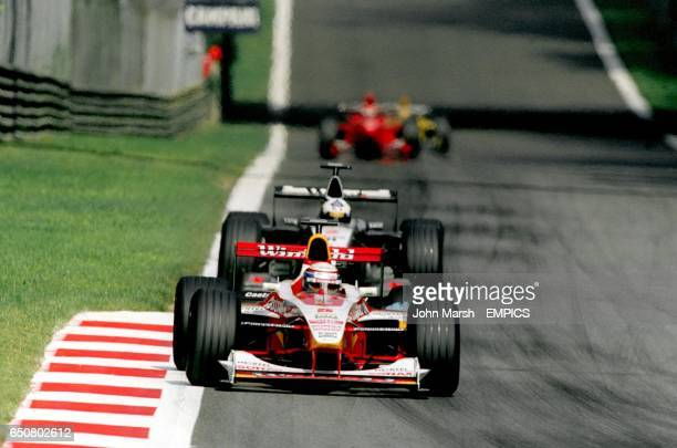 Alessandro Zanardi leads David Coulthard on his way to 7th place finish