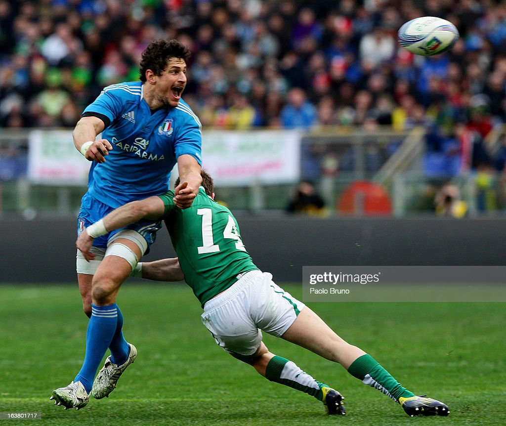 <a gi-track='captionPersonalityLinkClicked' href=/galleries/search?phrase=Alessandro+Zanni&family=editorial&specificpeople=876591 ng-click='$event.stopPropagation()'>Alessandro Zanni</a> of Italy (L) is tackled by Graig Girloy of Ireland during the RBS Six Nations match between Italy and Ireland at Stadio Olimpico on March 16, 2013 in Rome, Italy.