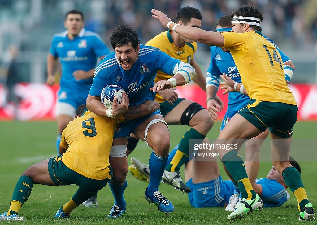 <a gi-track='captionPersonalityLinkClicked' href=/galleries/search?phrase=Alessandro+Zanni&family=editorial&specificpeople=876591 ng-click='$event.stopPropagation()'>Alessandro Zanni</a> of Italy is tackled by Will Genia of Australia during the international match between Italy and Australia at the Stadio Olimpico on November 9, 2013 in Turin, Italy.