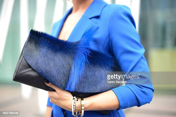 Alessia Canella poses wearing an Isabel Garcia jacket and Ted Baker bag on September 20 2014 in Milan Italy