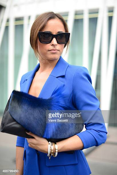 Alessia Canella poses wearing an Isabel Garcia jacket Ted Baker bag and Cline sunglasses on September 20 2014 in Milan Italy