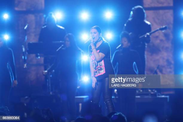 Alessia Cara performs during the JUNO awards show at the Canadian Tire Centre in Ottawa Canada April 2 2017 / AFP PHOTO / Lars Hagberg