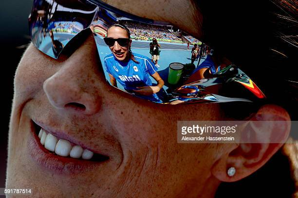 Alessia Trost of Italy is reflected in the glasses of Ruth Beitia of Spain during Women's High Jump Qualifying on Day 13 of the Rio 2016 Olympic...