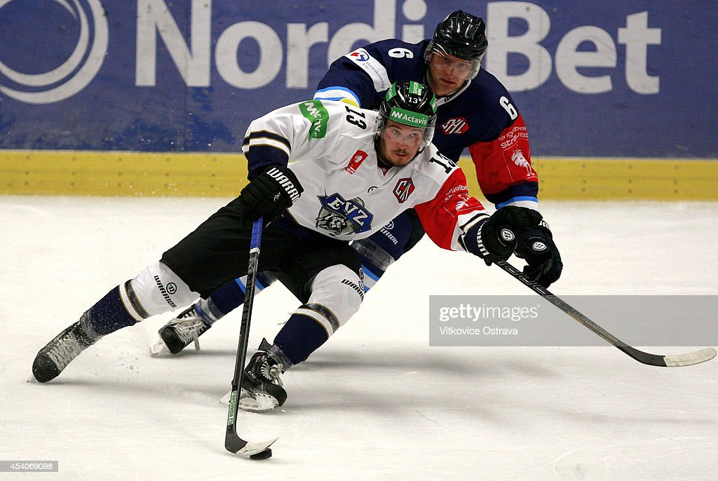 Alessio Bertaggia of EV Zug handles the puck during the Champions Hockey League group stage game between Vitkovice Ostrave and EV Zug on August 23, 2014 in Ostrava, Czech Republic.