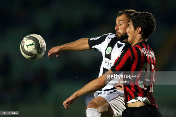 Alessio Campagnacci of Robur Siena battles for the ball with Michele Messina of Pro Piacenza during the Serie A match between Robur Siena and Pro...