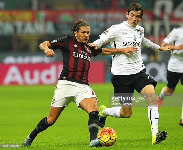 Alessio Cerci of AC Milan competes for the ball with Marten De Roon of Atalanta BC during the Serie A match between AC Milan and Atalanta BC at...
