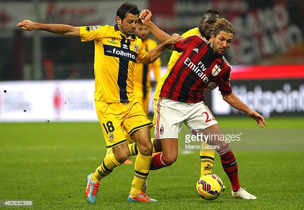 Alessio Cerci of AC Milan competes for the ball with Massimo Gobbi of Parma FC during the Serie A match between AC Milan and Parma FC at Stadio...