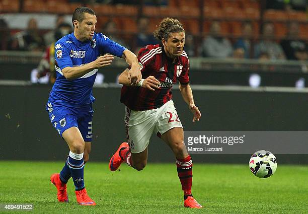 Alessio Cerci of AC Milan is challenged by Djamel Mesbah of UC Sampdoria during the Serie A match between AC Milan and UC Sampdoria at Stadio...