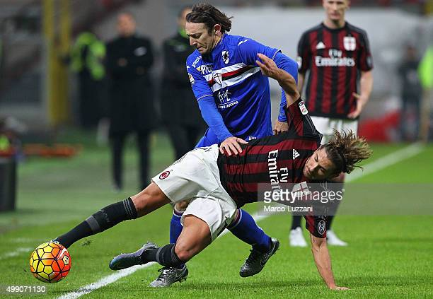 Alessio Cerci of AC Milan is challenged by Edgar Osvaldo Barreto of UC Sampdoria during the Serie A match between AC Milan and UC Sampdoria at Stadio...