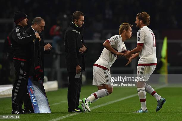 Alessio Cerci of AC Milan is replaced by Keisuke Honda during the Serie A match between Torino FC and AC Milan at Stadio Olimpico di Torino on...