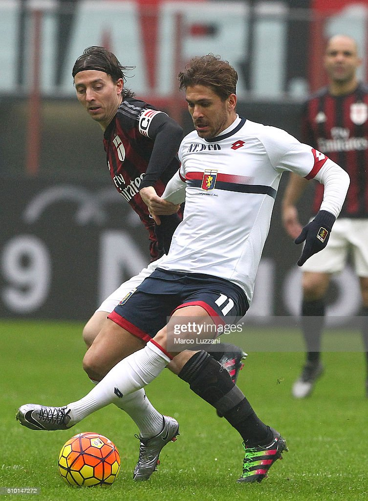 <a gi-track='captionPersonalityLinkClicked' href=/galleries/search?phrase=Alessio+Cerci&family=editorial&specificpeople=6166275 ng-click='$event.stopPropagation()'>Alessio Cerci</a> of Genoa CFC competes for the ball with <a gi-track='captionPersonalityLinkClicked' href=/galleries/search?phrase=Riccardo+Montolivo&family=editorial&specificpeople=605846 ng-click='$event.stopPropagation()'>Riccardo Montolivo</a> (back) of AC Milan during the Serie A match between AC Milan and Genoa CFC at Stadio Giuseppe Meazza on February 14, 2016 in Milan, Italy.