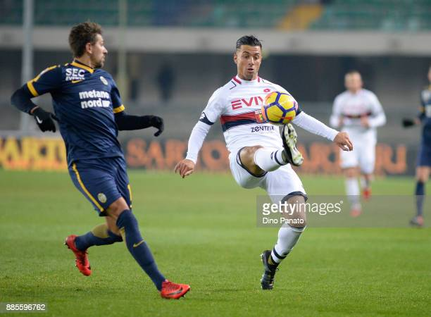 Alessio Cerci of Hellas Verona competes with Armando Izzo of Genoa CFC during the Serie A match between Hellas Verona FC and Genoa CFC at Stadio...