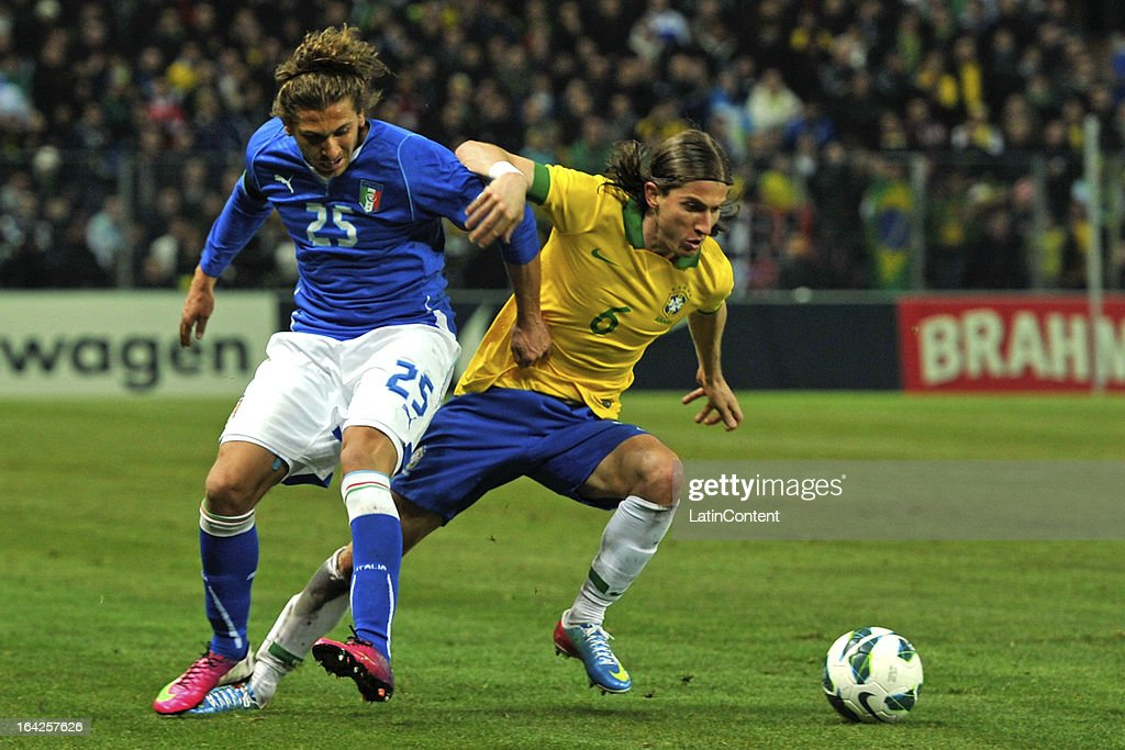 Alessio Cerci of Italy and <a gi-track='captionPersonalityLinkClicked' href=/galleries/search?phrase=Filipe+Luis&family=editorial&specificpeople=3941966 ng-click='$event.stopPropagation()'>Filipe Luis</a> of Brazil in action during the FIFA friendly match between Brazil and Italy on March 21, 2013 in Geneva, Switzerland.