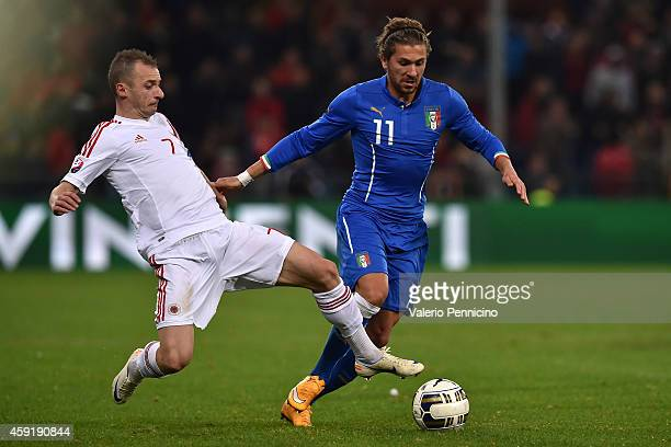 Alessio Cerci of Italy is tackled by Ansi Agolli of Albania during the International Friendly match between Italy and Albania at Luigi Ferraris on...