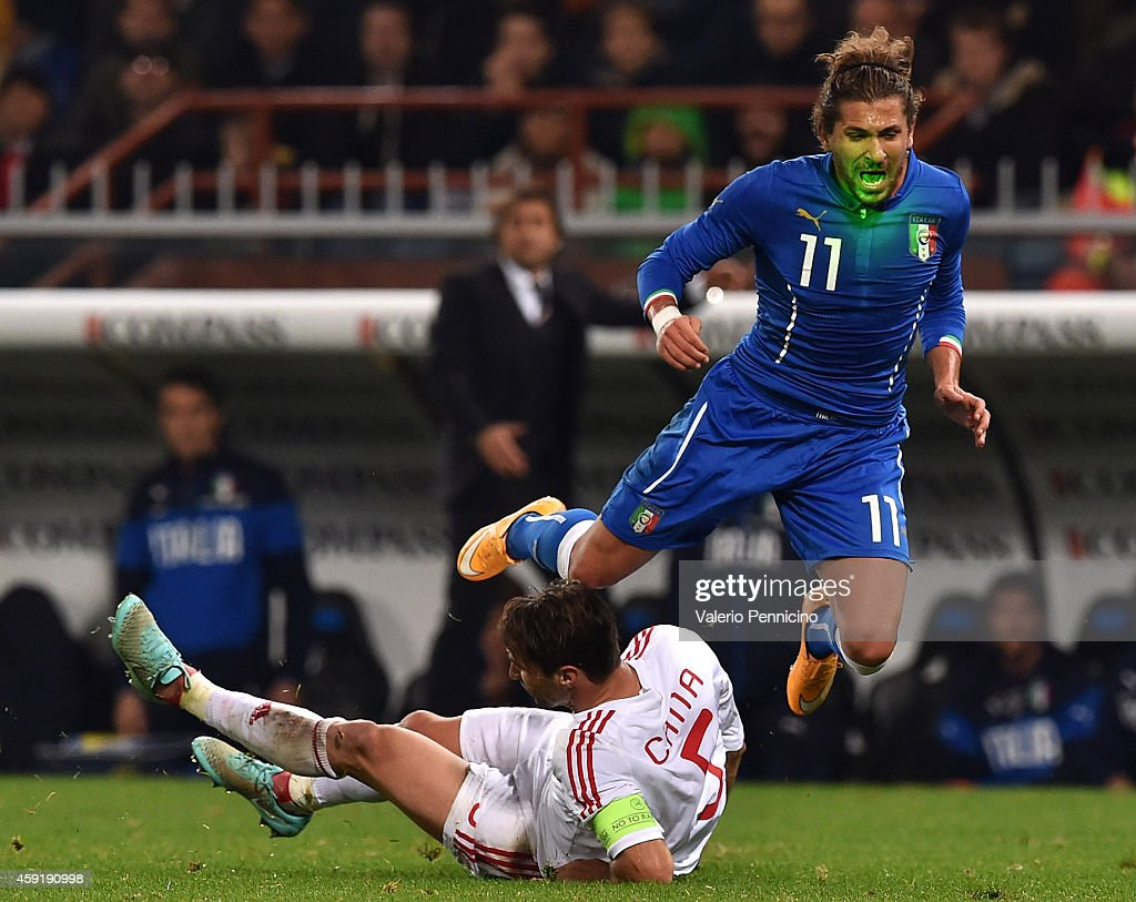 <a gi-track='captionPersonalityLinkClicked' href=/galleries/search?phrase=Alessio+Cerci&family=editorial&specificpeople=6166275 ng-click='$event.stopPropagation()'>Alessio Cerci</a> (R) of Italy is tackled by <a gi-track='captionPersonalityLinkClicked' href=/galleries/search?phrase=Lorik+Cana&family=editorial&specificpeople=662499 ng-click='$event.stopPropagation()'>Lorik Cana</a> of Albania during the International Friendly match between Italy and Albania at Luigi Ferraris on November 18, 2014 in Genoa, Italy.