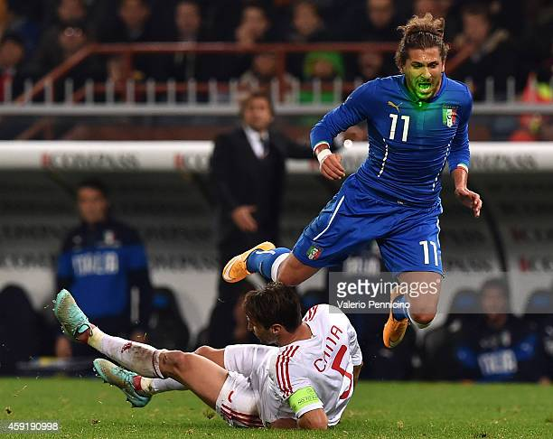Alessio Cerci of Italy is tackled by Lorik Cana of Albania during the International Friendly match between Italy and Albania at Luigi Ferraris on...