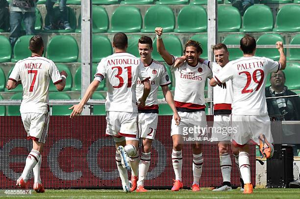 Alessio Cerci of Milan celebrates with team mates after scoring the opening goal during the Serie A match between US Citta di Palermo and AC Milan at...