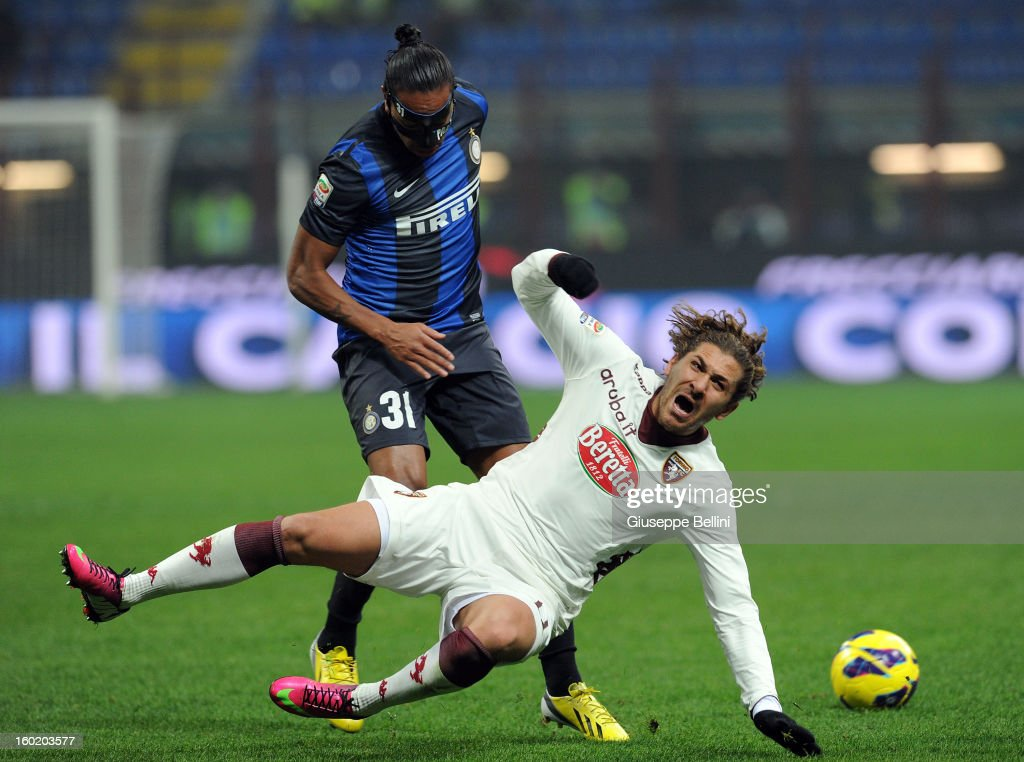 Alessio Cerci of Torino and <a gi-track='captionPersonalityLinkClicked' href=/galleries/search?phrase=Alvaro+Pereira&family=editorial&specificpeople=2577731 ng-click='$event.stopPropagation()'>Alvaro Pereira</a> of Inter in action during the Serie A match between FC Internazionale Milano and Torino FC at San Siro Stadium on January 27, 2013 in Milan, Italy.
