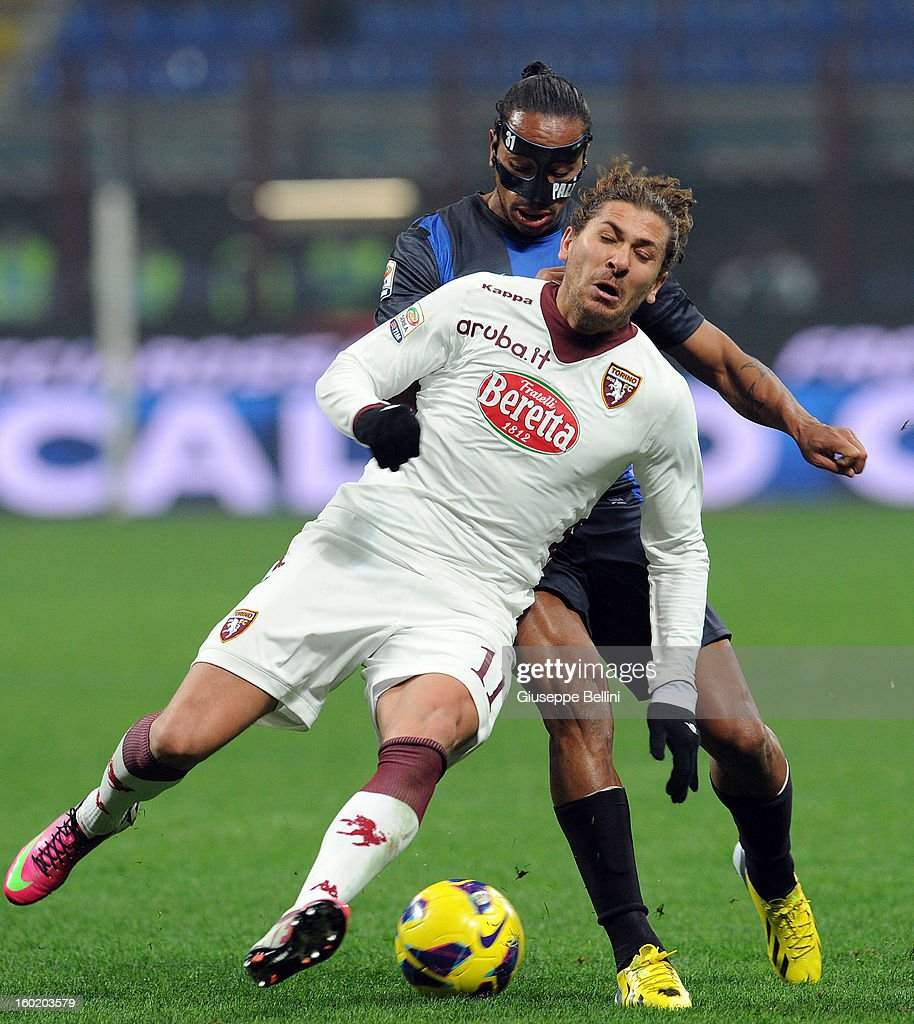 Alessio Cerci of Torino and Alvaro Pereira of Inter in action during the Serie A match between FC Internazionale Milano and Torino FC at San Siro Stadium on January 27, 2013 in Milan, Italy.