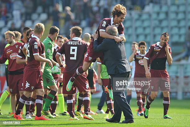 Alessio Cerci of Torino FC and head coach Giampiero Ventura celebrate victory at the end of the Serie A match between Torino FC and Genoa CFC at...