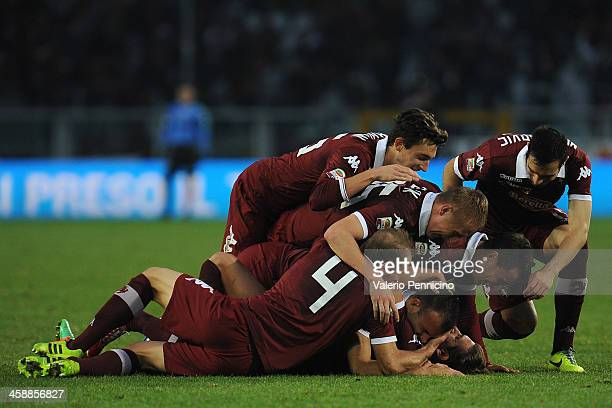 Alessio Cerci of Torino FC celebrates his goal with teammates during the Serie A match between Torino FC and AC Chievo Verona at Stadio Olimpico di...