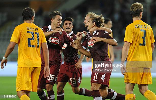 Alessio Cerci of Torino FC celebrates with his team mates after scoring the opening goal during the Serie A match between Torino FC and Hellas Verona...