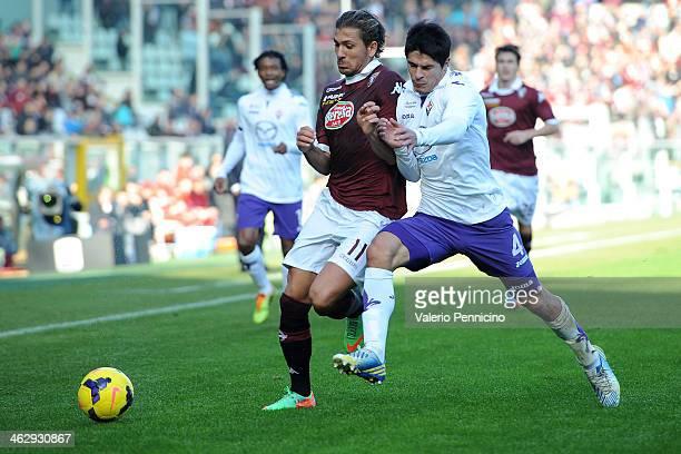 Alessio Cerci of Torino FC clashes with Facundo Sebastien Roncaglia of ACF Fiorentina during the Serie A match between Torino FC and ACF Fiorentina...