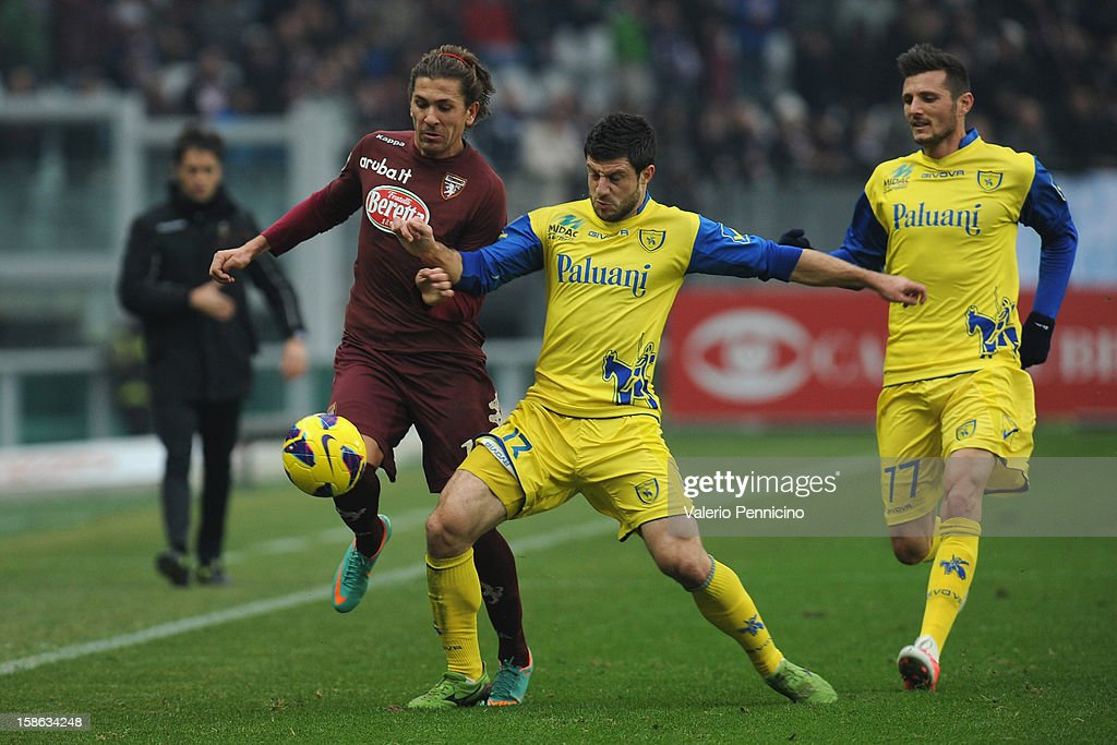 Alessio Cerci (L) of Torino FC competes with <a gi-track='captionPersonalityLinkClicked' href=/galleries/search?phrase=Bojan+Jokic&family=editorial&specificpeople=4209230 ng-click='$event.stopPropagation()'>Bojan Jokic</a> of AC Chievo Verona during the Serie A match between Torino FC and AC Chievo Verona at Stadio Olimpico di Torino on December 22, 2012 in Turin, Italy.
