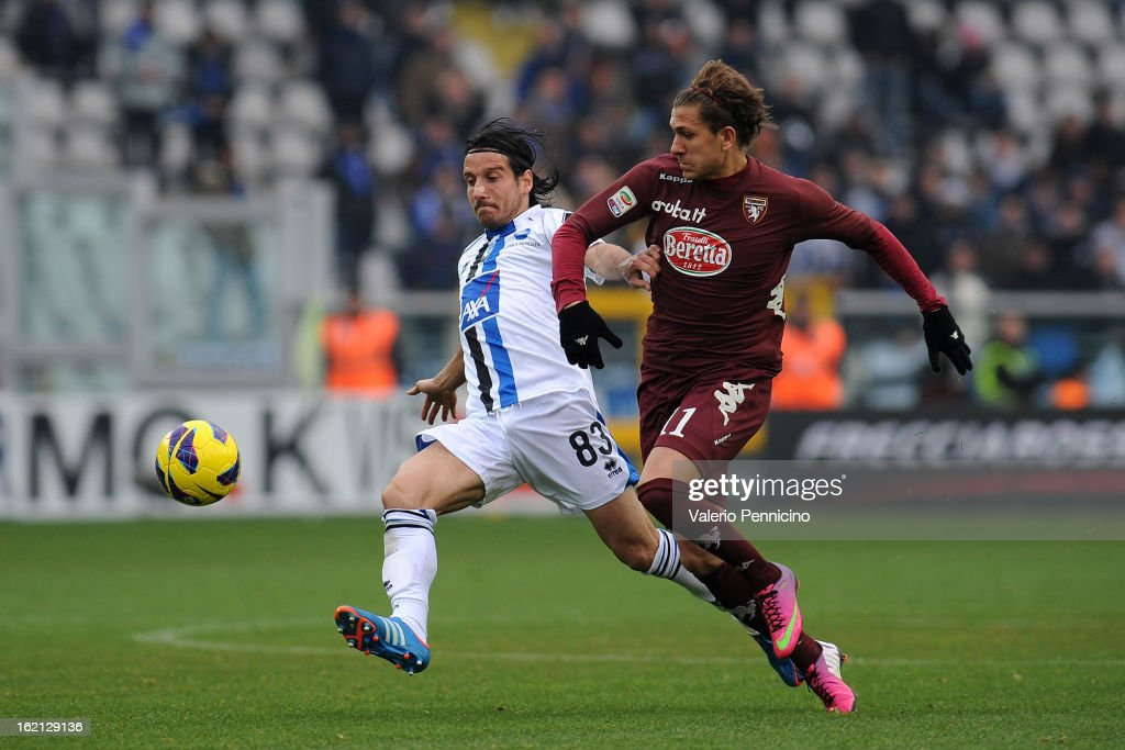 Alessio Cerci (R) of Torino FC competes with Cristiano Del Grosso of Atalanta BC during the Serie A match between Torino FC and Atalanta BC at Stadio Olimpico di Torino on February 17, 2013 in Turin, Italy.