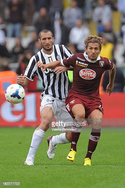 Alessio Cerci of Torino FC competes with Giorgio Chiellini of Juventus during the Serie A match between Torino FC and Juventus at Stadio Olimpico di...