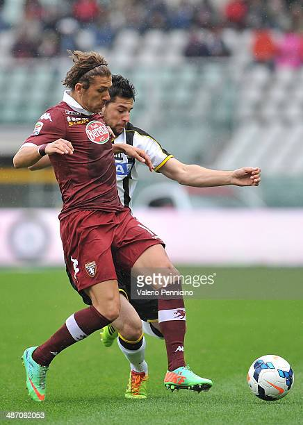 Alessio Cerci of Torino FC competes with Igor Bubnjic of Udinese Calcio during the Serie A match between Torino FC and Udinese Calcio at Stadio...