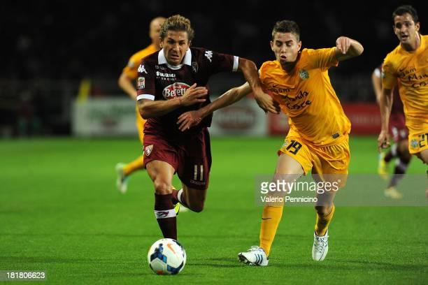 Alessio Cerci of Torino FC competes with Jorge Luiz Frello of Hellas Verona FC during the Serie A match between Torino FC and Hellas Verona FC at...