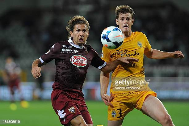 Alessio Cerci of Torino FC competes with Michelangelo Albertazzi of Hellas Verona FC during the Serie A match between Torino FC and Hellas Verona FC...