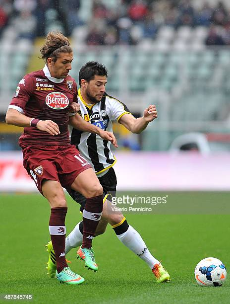 Alessio Cerci of Torino FC compets with Igor Bubnjic of Udinese Calcio during the Serie A match between Torino FC and Udinese Calcio at Stadio...