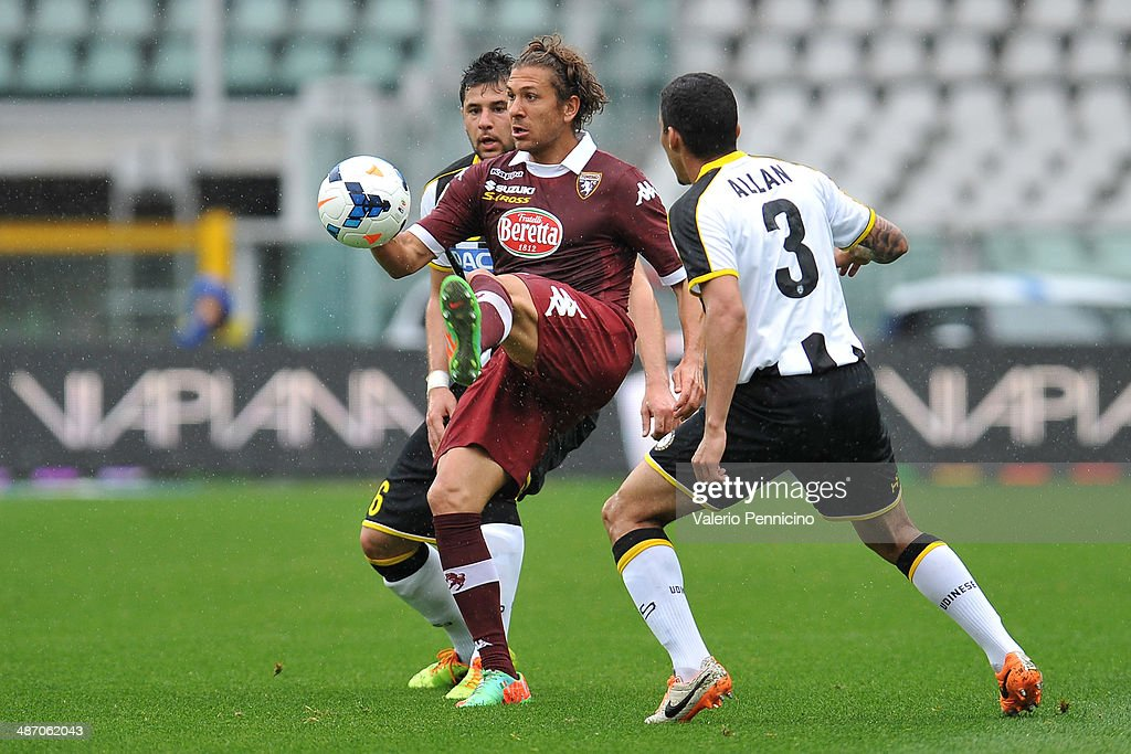 <a gi-track='captionPersonalityLinkClicked' href=/galleries/search?phrase=Alessio+Cerci&family=editorial&specificpeople=6166275 ng-click='$event.stopPropagation()'>Alessio Cerci</a> (C) of Torino FC controls the ball during the Serie A match between Torino FC and Udinese Calcio at Stadio Olimpico di Torino on April 27, 2014 in Turin, Italy.