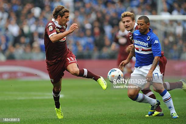 Alessio Cerci of Torino FC in action against Angelo Palombo of UC Sampdoria during the Serie A match between UC Sampdoria and Torino FC at Stadio...