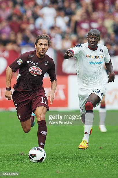 Alessio Cerci of Torino FC in action against Victor Ibarbo of Cagliari Calcio during the Serie A match between Torino FC and Cagliari Calcio at...