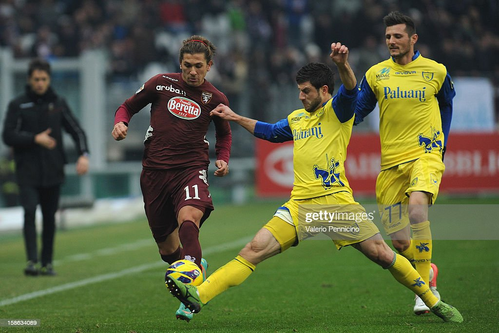 Alessio Cerci (L) of Torino FC is challenged by <a gi-track='captionPersonalityLinkClicked' href=/galleries/search?phrase=Bojan+Jokic&family=editorial&specificpeople=4209230 ng-click='$event.stopPropagation()'>Bojan Jokic</a> of AC Chievo Verona during the Serie A match between Torino FC and AC Chievo Verona at Stadio Olimpico di Torino on December 22, 2012 in Turin, Italy.