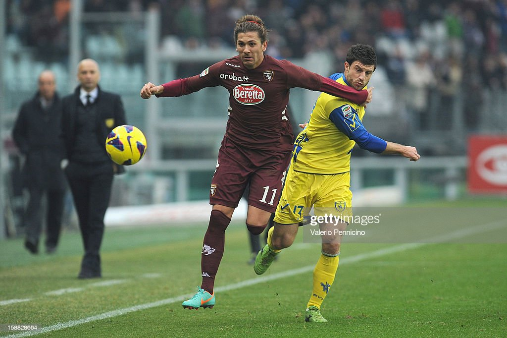 Alessio Cerci (L) of Torino FC is challenged by Bojan Jokic of AC Chievo Verona during the Serie A match between Torino FC and AC Chievo Verona at Stadio Olimpico di Torino on December 22, 2012 in Turin, Italy.