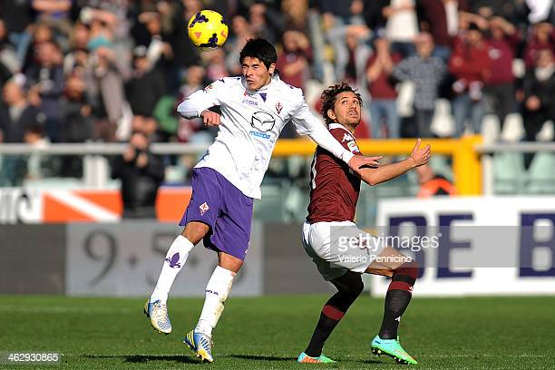 Alessio Cerci of Torino FC is challenged by Facundo Sebastien Roncaglia of ACF Fiorentina during the Serie A match between Torino FC and ACF...