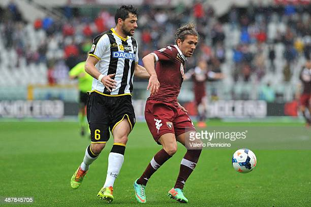 Alessio Cerci of Torino FC is challenged by Igor Bubnjic of Udinese Calcio during the Serie A match between Torino FC and Udinese Calcio at Stadio...