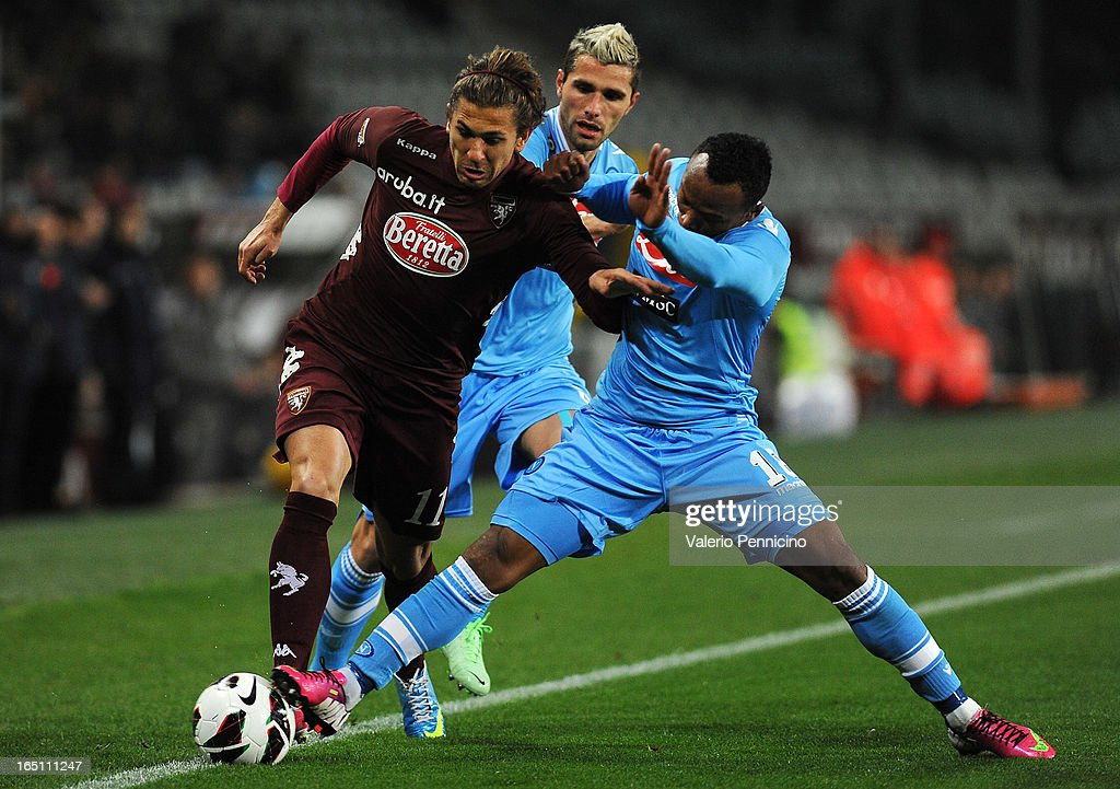 Alessio Cerci (L) of Torino FC is challenged by Juan Camilo Zuniga of SSC Napoli during the Serie A match between Torino FC and SSC Napoli at Stadio Olimpico di Torino on March 30, 2013 in Turin, Italy.