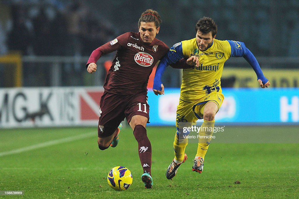 Alessio Cerci (L) of Torino FC is challenged by <a gi-track='captionPersonalityLinkClicked' href=/galleries/search?phrase=Perparim+Hetemaj&family=editorial&specificpeople=4143278 ng-click='$event.stopPropagation()'>Perparim Hetemaj</a> of AC Chievo Verona during the Serie A match between Torino FC and AC Chievo Verona at Stadio Olimpico di Torino on December 22, 2012 in Turin, Italy.
