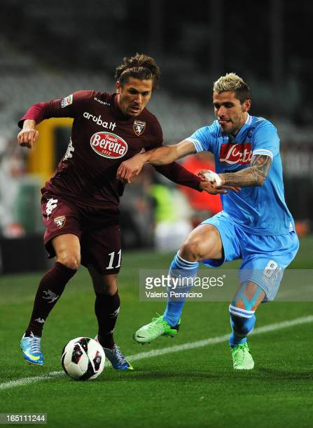 Alessio Cerci of Torino FC is challenged by Valon Behrami of SSC Napoli during the Serie A match between Torino FC and SSC Napoli at Stadio Olimpico...